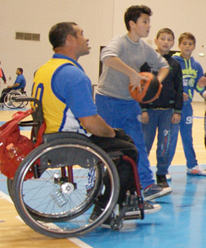 Photo of people playing wheelchair basketball.