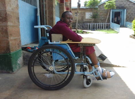 Photo of Christine in her new wheelchair