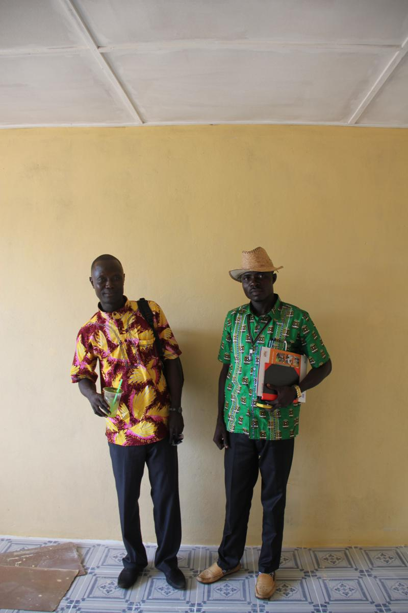 Amadu Konneh and Joseph Diggs stand in the newly renovated office.