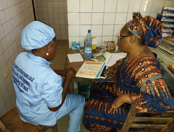 Photo of two women reviewing literature at a clinic.