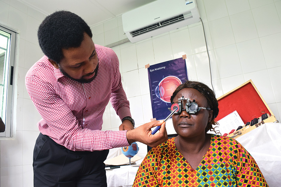 Photo of Dr. Inyene Edem Udofia with a client
