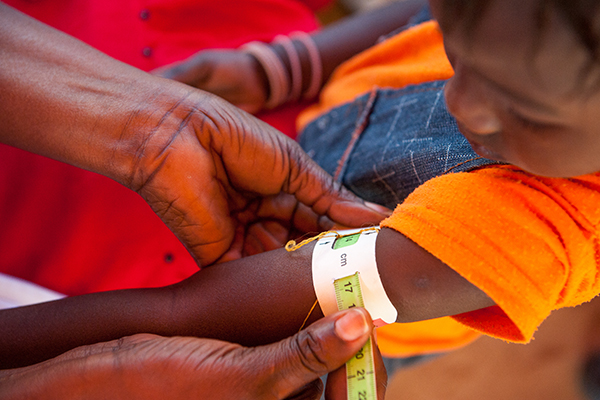 Photo of a child's arm being measured in Senegal, 2012. Photo ©Croix-Rouge sénégalaise et française/Guillaume Bassinet
