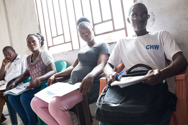 Photo of people in a CHW training session in Sierra Leone. Credit: Joshua Yospyn/JSI
