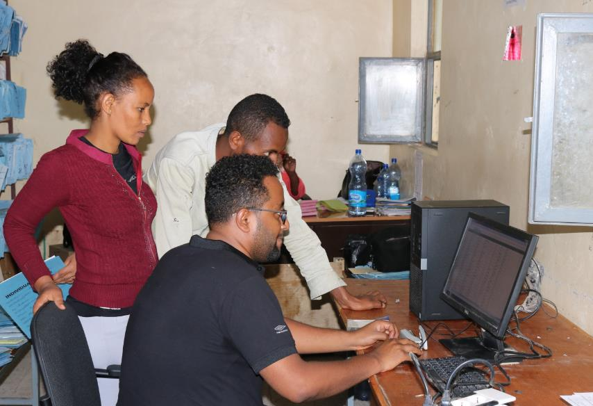 Photo of Negash and his colleagues using Health Net at a local facility.