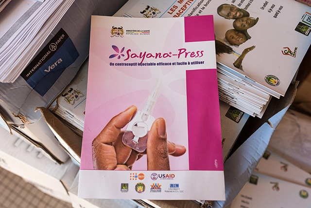 Photo of Sayana-Press brochures on a stack of materials.
