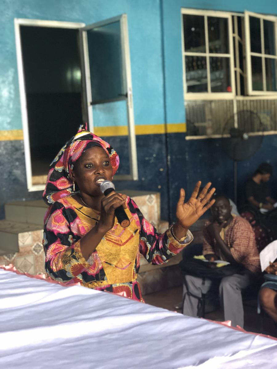 Isatu Bangura tells her fellow learners at the SLAES Literacy Class graduation ceremony how she feels empowered and now wants to continue her education.