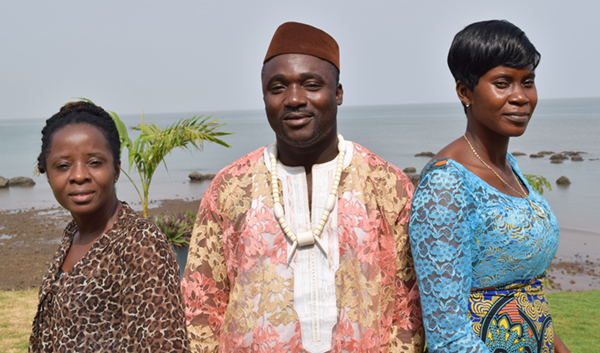 Photo of three people at an APC Liberia survivors workshop.