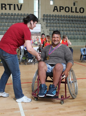 Photo of Marius in a wheelchair on a basketball court.