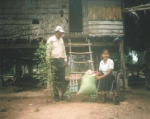 Photo of Hout Thoeung outside in a wheelchair
