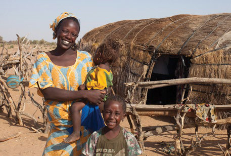 Photo of a mother smiling with two children.