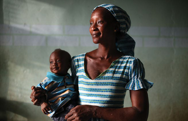 Photo of a woman holding a small child.