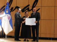 Angela De Leon Navarro receives an award