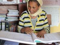 Photo of Alemnesh Assefa working indoors
