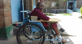 Photo of Christine in a wheelchair