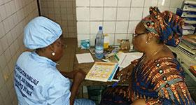 Photo of two women at a clinic reviewing literature