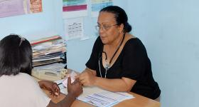Photo of health provider Dr. Sonia Ramirez at the CEPROSH clinic seeing a patient