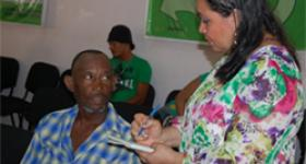 Regional Health Service personnel going over the satisfaction survey with a patient in the Hospital Doctor Antonio Musa, in San Pedro de Macoris.