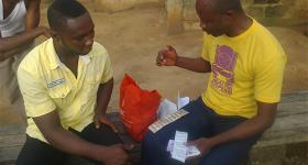 Photo shows Nana Akorlegah educating his male colleagues in his community on the use of condoms