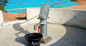 Photo of a 295-foot borehole that provides clean water to Kolahun Hospital.