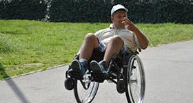 Photo of Marius popping a wheelie in his wheelchair