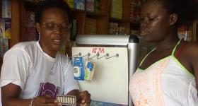 Mrs. Patience Gyasi explains how to use the secure pill to a client.