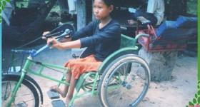 Photo of Hout Thoeung on a tricycle with hand cranks