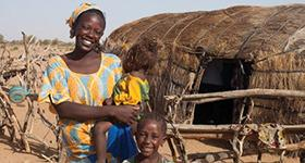 Photo of a woman with two children, source IFPRI/Milo Mitchell