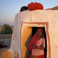 Photo of a woman standing in a doorway